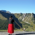 Alphorn player at the summit station